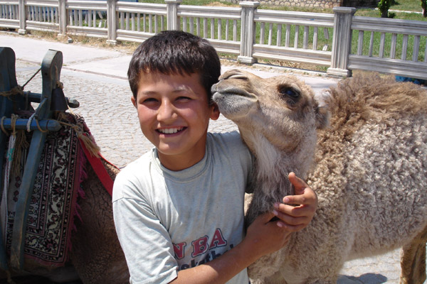 Local boy with pet camel