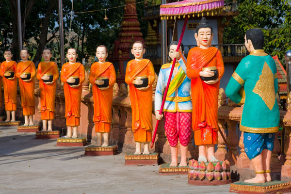 Wooden statues of monks at Sihanoukville