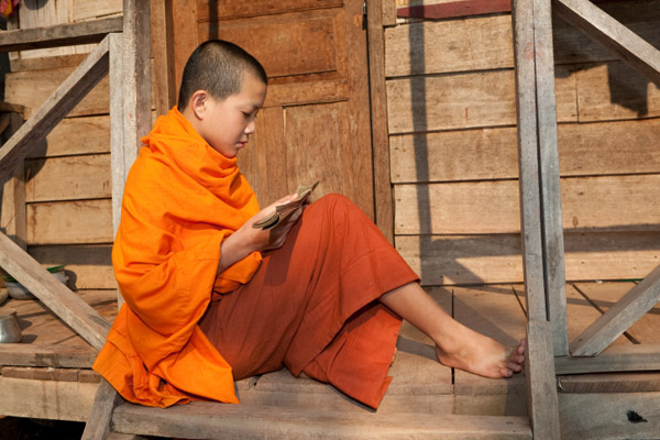 Young boy studying to become a monk